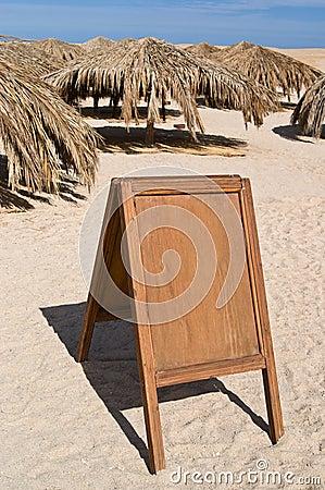 Blank billboard on sand beach