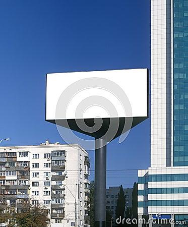 Blank billboard taken against a blue sky.