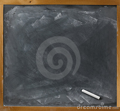 Blank blackboard and chalk straight on