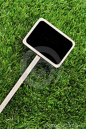 Blank blackboard label on the grass