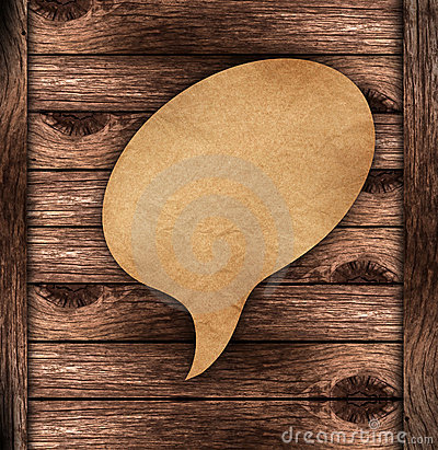 Blank Brown paper Speech on wood background