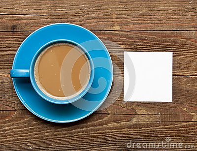 Blank card on coffee cup