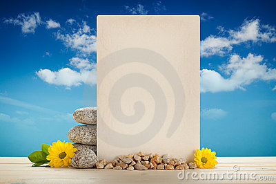 Blank card, stones and flowers