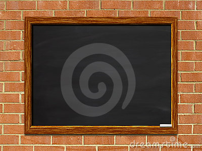 Blank chalkboard on brick
