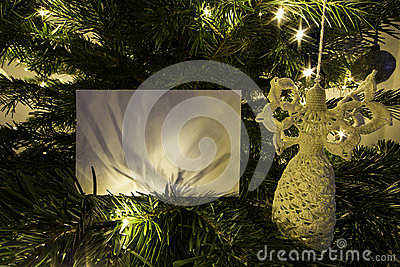 Blank Christmas Card with Angel toy on Christmas Tree