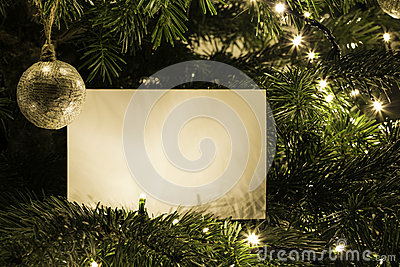 Blank Christmas Card on the Christmas Tree with toy