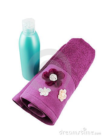 Blank cyan shampoo bottle and purple towel