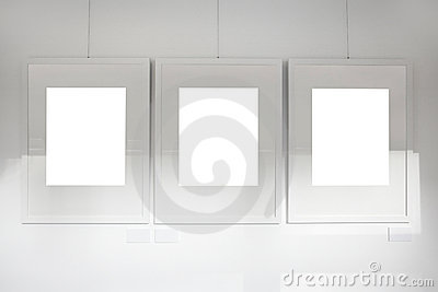 Blank frames on art gallery white wall