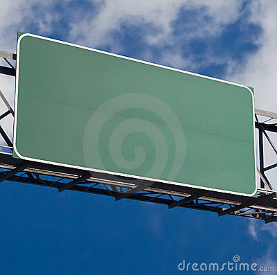 Blank freeway sign in blue cloudy sky