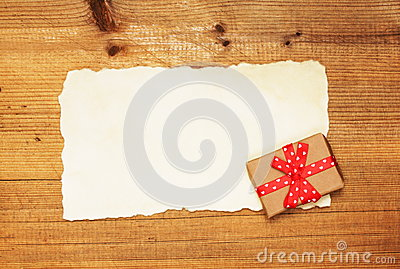 Blank and gift box on wooden background