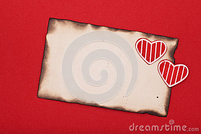 Blank grunge burnt paper and two hearts