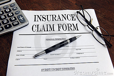 Blank insurance claim form and pen
