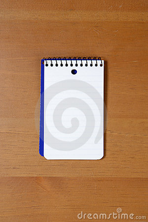 A blank note pad on a desk