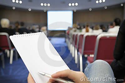 Blank notebook at conference hall.