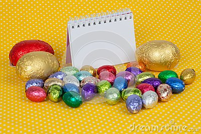 Blank notebook with Easter chocolate eggs.