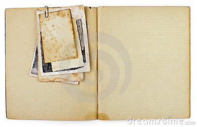 Blank old opened diary with photos