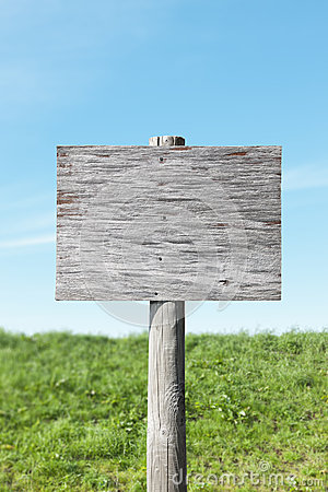 Blank old sign on sunny day
