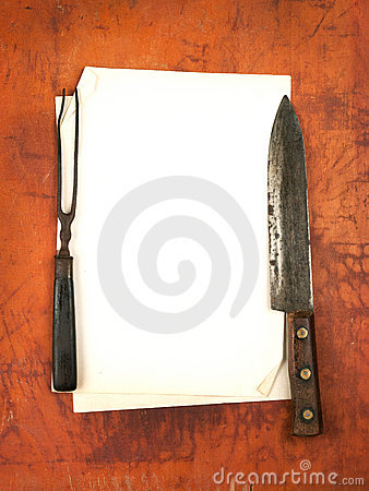 Blank paper menu with knife and fork as background