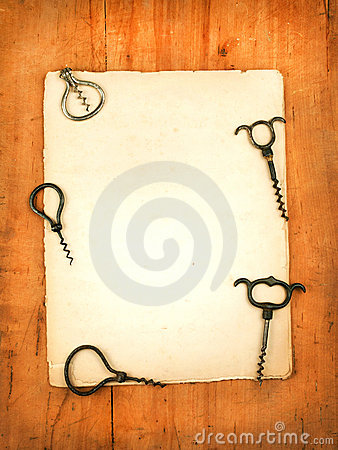 Blank paper menu with wine openers as backgroung