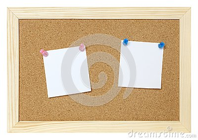 Blank papers on cork board