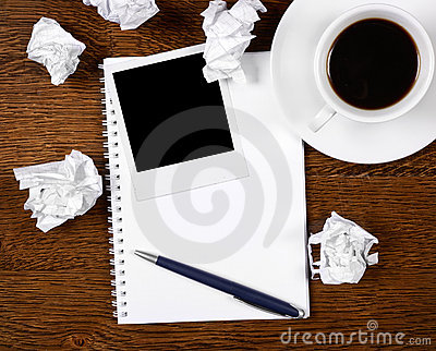Blank photo on notepad with pen