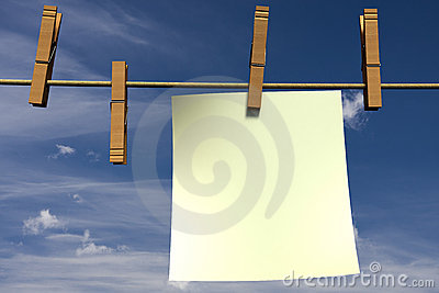 Blank piece of paper hanging on a rope