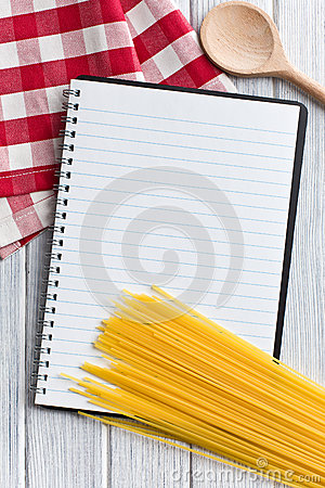 Blank recipe book with italian spaghetti