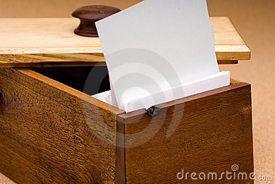 Blank recipe card in a wooden box