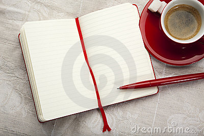 Blank ruled notebook and espresso on table