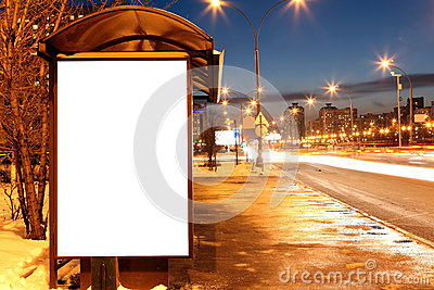 Blank sign at bus stop at evening