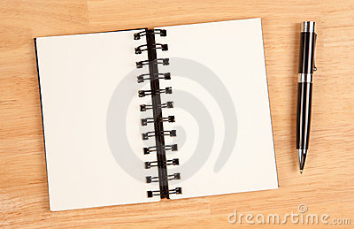 Blank Spiral Note Pad and Pen on Wood