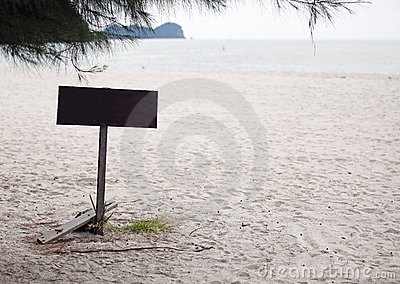 Blank timber signboard at beach