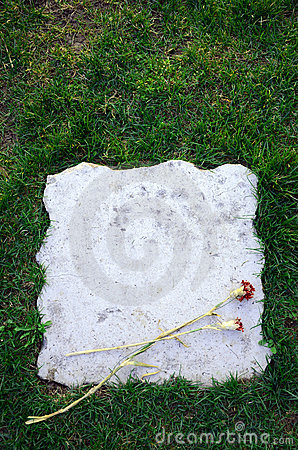 Blank tombstone with flower