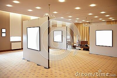 Blank white frames in art gallery