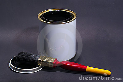 Blank White Paint Tin With Paintbrush and Lid in the Foreground