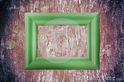 Blank wood frame on grunge brick wall