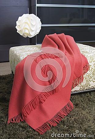 Blanket over an ottoman