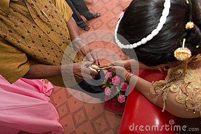 Blessed water poured out in thai wedding ceremony