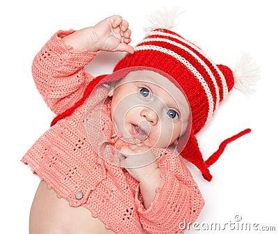 Blije baby in een hoed
