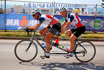 Blind triathlete on tandem bike Editorial Stock Image
