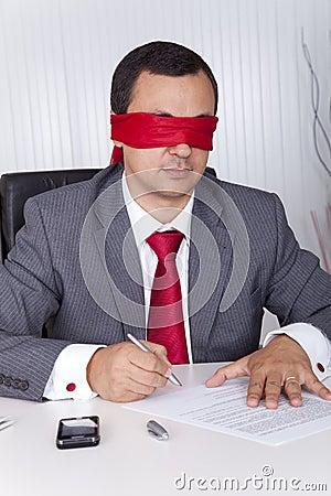 Blindfold businessman working