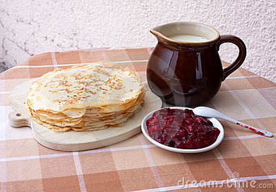 Blini with milk and berry jelly
