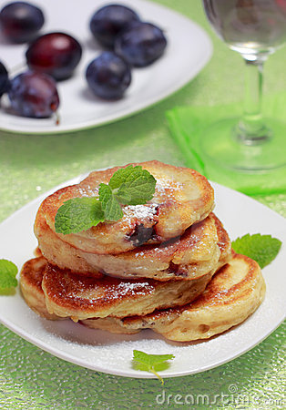 Blinis (from white flour, with plum) on plate
