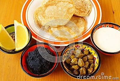 Blintzes with caviar