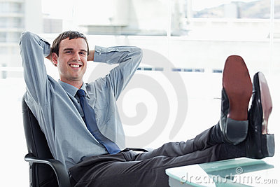 Blissful manager relaxing