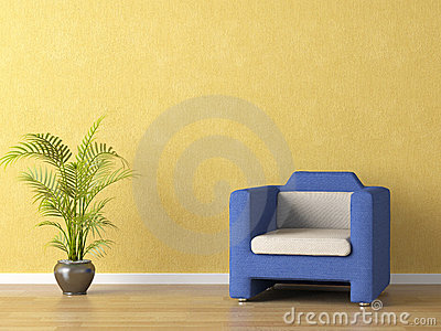 Bllue couch on yellow wall