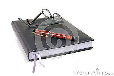 Bloc - notes avec le crayon lecteur et les points