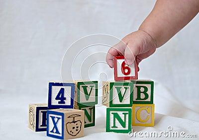 Blocks and baby hand