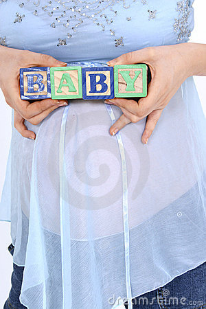 Blocks Spelling Baby Above Expecting Mom s Belly