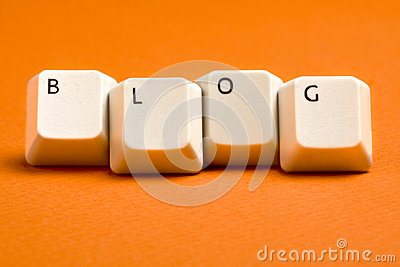 Blog White Keyboard Keys on Orange